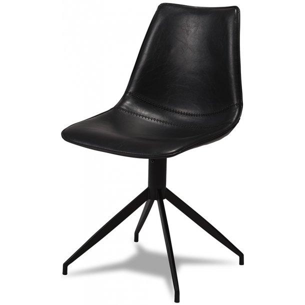Irma spisebordstol med skåleformet sæde og ryg i sort læder look og sort stel